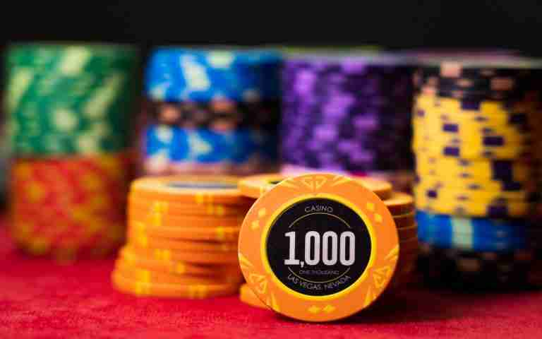 High value casino chips on a gaming table